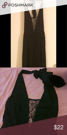Wide leg romper jumpsuit Black romper jumpsuit with sheer floral design in front/open back design. Wide leg design. Size L Forever 21 Pants Jumpsuits & Rompers