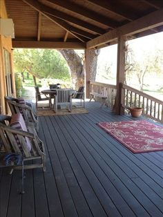 The covered veranda outside the living room in The Barn Quarters with barbeque. Perfect for potluck wedding