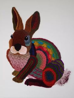 Freeform crocheted Rabbit on framed canvas 40x50 cm/ 15,75 x19,69 inch created March 2017_Ann Benoot