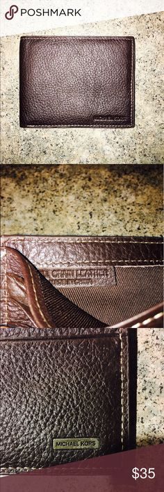 Men's Michael Kors wallet NWOT brown leather Michael Kors wallet for men. bought for my husband but he prefers black. has not been used! in perfect condition! Michael Kors Accessories Money Clips