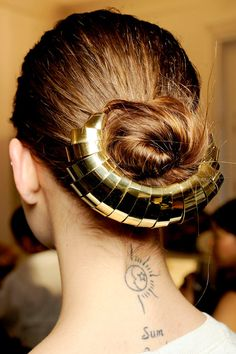 Thought buns were boring? Think again. Stunning golden accessories brighten up low-slung coils: be creative!