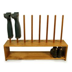 Oak Wellington boot and shoe rack for four pairs of boots  Features:  ∙ Wellington and shoe storage rack hand-crafted in local, solid Cornish oak. ∙ Holds 4 pairs of wellington boots and 4 pairs of shoes or walking boots. ∙ Hold your wellingtons upside down to keep them dry and allow them to air naturally. ∙ Slotted shoe shelf allows dirt to fall through. ∙ Supplied oiled and ready assembled. ∙ Now available with extra shoe shelf ∙ 100cm W x 25cm D x 74cm H (100cm High with extra ...