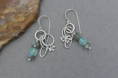 These earrings are funky, rustic and Bohemian. They are so pretty and very versatile. They are great for everyday, but special enough for evening.  The hoops and chain links are made from fine silver which I fused, hammered and gave a light patina. The ear wires are made from Sterling Silver. I dangled a column of shimmering Labradorite beads and cubes of blue Chalcedony from the hoops and I also made small Silver droplets. These are very unique. These are approximately 1 7/8 inches long...