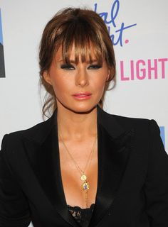Melania Trump Messy Updo - Melania Trump's messy updo highlighted her wispy bangs at the 'Celebrity Apprentice' live finale in NYC.