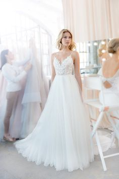 Kai- Style 1820 Ivory tulle A-line gown, beaded lace bodice with scalloped sweetheart neckline and low scoop back, full gathered tulle skirt.