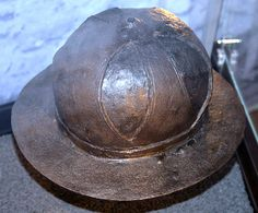 European iron helmet, from a mass grave, battle of Visby, fought in July 1361 on the Swedish Baltic island of Gotland, between invading Danish troops and the local Gutnish forces. The Danish won a decisive victory. Due to the heat, the dead had to be disposed of quickly, and many were buried in their armour. The archaeological excavation of one of the mass graves, in the 1930s, revealed over 1000 skeletons.