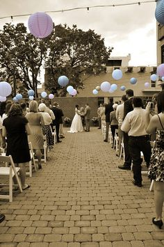 The lanterns are a cool idea if the wedding and reception are going to be in the same space, double duty decorations