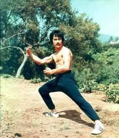 Bruce Lee with mustache. I love the rare Bruce Lee photos.
