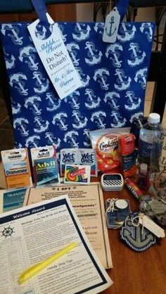 Cruise wedding favors gift bag for cruisers. Has i spy game, important info, highlivhter, dramamine, advil, hugs n kisses, mints, lifesaver, anchor luggage tags, anchor bottle opener, hand sanitizer, snacks and water for sailing wedding guests.