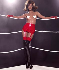Miss March in the 2015 Pirelli calendar is Joan Smalls wearing Syrens Cuban Heel Stockings. Shot by Steven Meisel and styled by Carine Roitfeld http://www.syren.com/latex-stockings-lingerie-p-529-cuban-heel-stocking.aspx