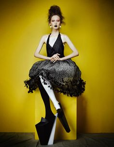 Wooden platform shoes by Atlanta Weller. Lace tulle dress by Chanel. Photographer: Damian Foxe.