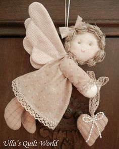 Ulla's Quilt World: Quilted angel, pattern and tutorial - She is adorable.  This site has many nice patterns.