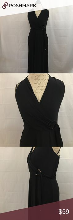 "White House Black Market elegant full length dress Full length behind the neck dress. Attached belt with silver embellishment at waist. Very stretchy material. Unstretched waist is 27"". Waist to hem: 43"". White House Black Market Dresses Maxi"
