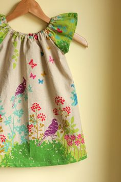 This has to be one of the loveliest dresses I have ever seen. If I sell enough of the kids' old clothes on Ebay ...