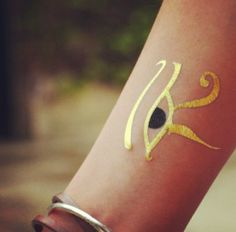 gold eye of horus forearm tattoo for girls and women