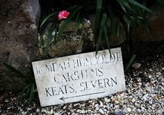 Pointing the way toward the grave of John Keats in the non-Catholic cemetery of Rome.