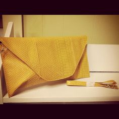 Yellow gold envelope clutch -$20.99