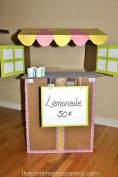 Don't toss your old cardboard boxes. Upcycle them into fun. Cardboard box lemonade stand for the kids