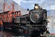 Walk on the wild side: Kate leads her husband next to a steam train surrounded by beautifu...