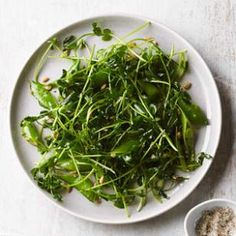Pea Shoot & Snap Pea Salad with Sunflower Seeds | Grassy, sweet pea shoots add another layer of pea flavor to this light spring salad recipe. Look for them near other sprouts or at Asian markets and farmers' markets.