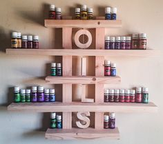 Wood, Essential Oils, Shelf, rack, storage, wall, hanging, Handmade, Decor, distressed, white wash, nail polish rack, salon, Young living by HisHersWoodworking on Etsy https://www.etsy.com/listing/266345702/wood-essential-oils-shelf-rack-storage