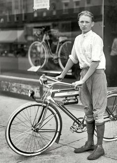 "Washington, D.C., circa 1921. ""Times boy and bicycle."" One of the winners of a Washington Times subscription-selling contest and his prize, a Mead Ranger bike."