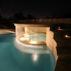 Hot tub waterfall. Wow....  I need this!