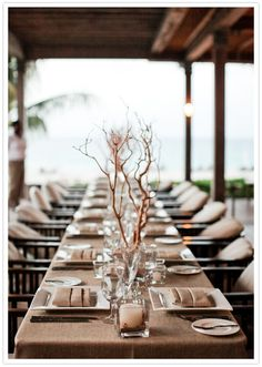 Simple branches and linens don't compete with the Caribbean views at a Viceroy Anguilla dinner party.