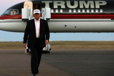 Republican presidential nominee Donald Trump walks off his plane at a campaign rally in Colorado Springs, Colo., Sept. 17, 2016. (Photo by Mike Segar/Reuters)