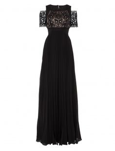 The Temperley London Long Catherine Dress has a black lace panel underlaid with nude silk across the bust while the sleeve has intricate sheer lace work to reveal the arm underneath. The neck panel is surrounded with a black yoke that fastens with a single button at the nape of the neck and scoops down to reveal a flattering stretch of bare skin on the back. The skirt is made from softly pleated silk, unfastening at the small of the back and falling in a gentle swathe to the floor. A…