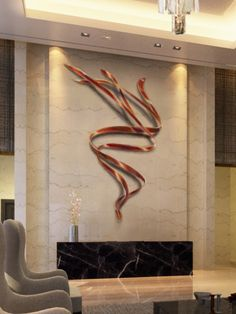 White marble with bronze wall art sculpture in the reception area of the lobby.  Artist:  Eric Peltzer