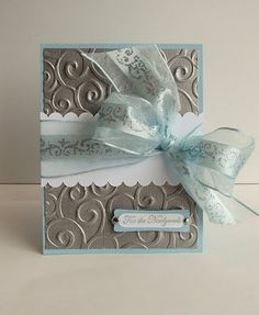 Wedding Card - my mum has this cuttlebug that makes the exact same pattern! Silver and purple with blue/teal ribbon?