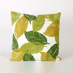 A pretty leaf print pillow would be perfect to brighten up a crisp, white chair.