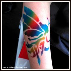 For all my followers who know I am addicted to airbrushing rainbow coloured designs...here is another airbrushed fairy. :)  www.tattooedsister.com