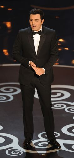 Seth MacFarlane in a Gucci Made to Order black grosgrain notch lapel two button Marseille tuxedo.