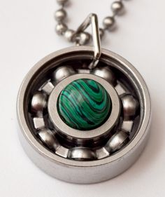 Happy St. Patrick's Day! Do you have your green on? I decided to wear a malachite pendant as part of my green today (isn't it pretty?). The swirls are my fave! Grab one of your own – remember they're derby girl tested & approved! #derbygirldesigns #bearingjewelry #jewelrythatrocks #malachite #stpatricksday #wearyogreen #leapingleprachauns
