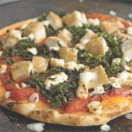 Spread marinara on flat bread. Add some spinach, feta cheese, and precooked chicken breast. Cook for 6 min at 375.