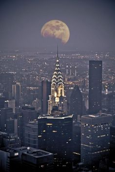 """""""If you get caught between The Moon & New York City...the best that you can do...is fall in love """"  (Full winter moon and the Chrysler building, New York)"""