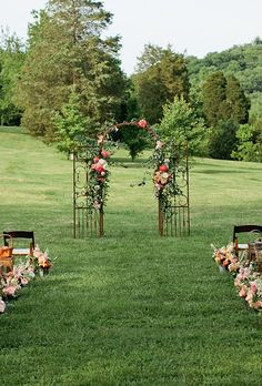 An iron gate covered with greenery and bright blooms, created by Cedarwood Weddings.