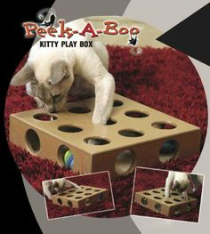 PEEK-A-BOO KITTY PLAY BOX Heavy-duty wood toy box to hide toys inside. Keeps curious cats mentally and physically sharp. Works with almost any appropriately sized toy or catnip. Encourages cats natural predatory behavior. Rotate toys for extra fun..Includes 2 soft colorful balls.
