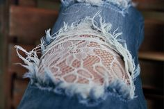 "Torn jeans ""patched"" with lace."