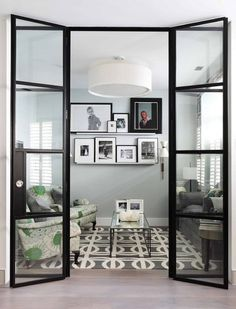 Cheat with a rug. Painting a floor black is a big commitment, so if you're unsure, cheat with a rug instead. The geometric lines of the wool rug here chime nicely with the doors and picture frames for a cohesive look.