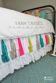 Attach some simple yarn tassels to your bedskirt.