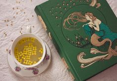 A book of magic and a cup of herbal tea.