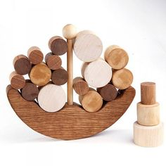 PRODUCT DESCRIPTION: Ship wooden balance toy helps your child to develop gross and fine motor skills, hand-eye coordination, eye sight
