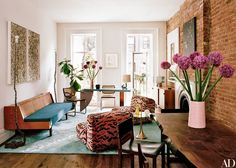 Vintage Knoll lounge chairs, upholstered in a velvet tiger print by Luigi Bevilacqua, face a vintage Hans Wegner daybed in the study of Laure Heriard Dubreuil's New York rowhouse   archdigest.com