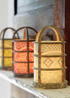 Take simple industrial light covers and turn them into glowing luminaries.  Just add some pretty vellum a tea lights and you're all set.