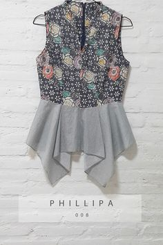 Phillipa 008 IDR 520.000 V-Neck Body Fit Floral Batik Cap with Pearl Embellishment Top Length of Blouse : (From Top to Bottom) 74 cm. Material Used : Batik Cap, Cotton. Pearl Embellishment. Standard Zipper Length (50-55cm) at the back