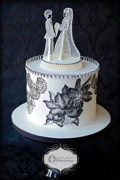Classy wedding cake with an update on a traditional cake toppers