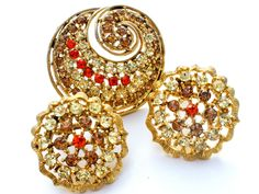 High End Costume Jewelry - This is a gold tone brooch and earring set just loaded with color. All pieces are round in colors of orange, topaz brown and champagne rhinestones. The brooch measures 1.5 i